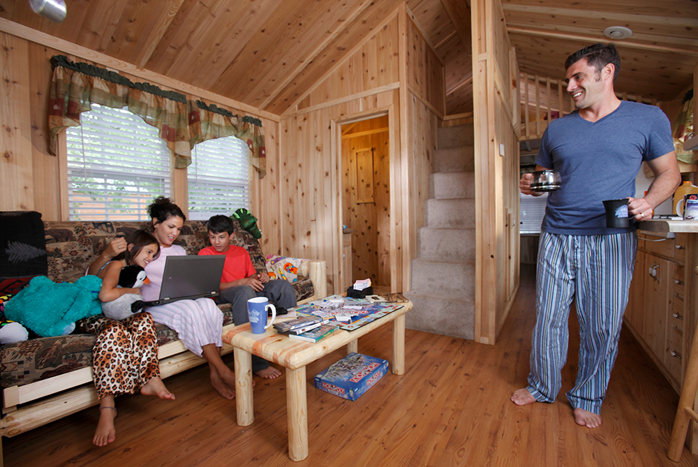Family relaxing inside cabin