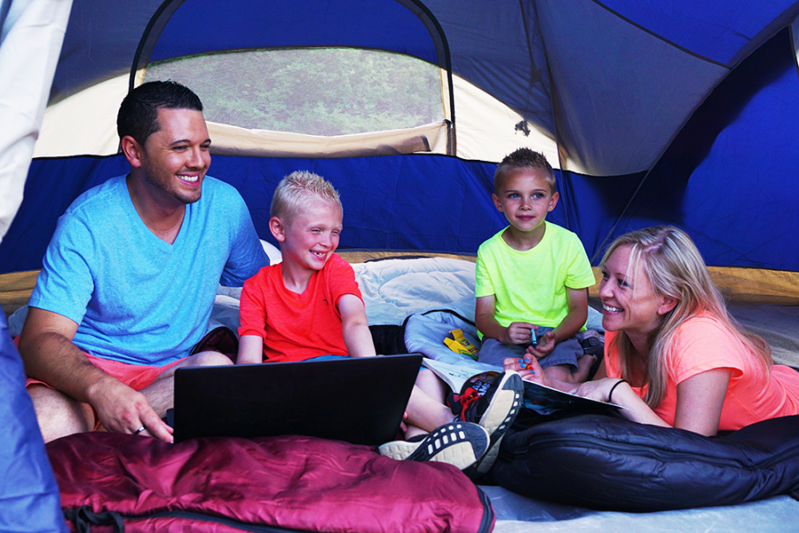 Family relaxing in tent