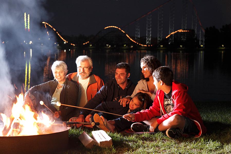 Family roasting marshmallows over a campfire